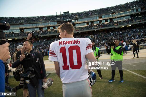 New York Giants quarterback Eli Manning walks off the field after his team's 2417 loss against the Oakland Raiders on Sunday Dec 3 2017 at the...