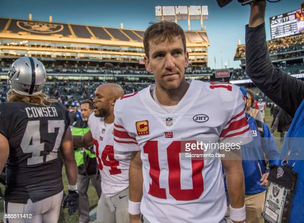New York Giants quarterback Eli Manning walks off the field after his teamaposs 2417 loss against the Oakland Raiders on Sunday Dec 3 2017 at the...