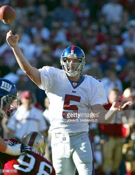 New York Giants' quarterback Kerry Collins throws a touchdown pass to Giants' wide-receiver Amani Toomer against the San Francisco 49ers during the...