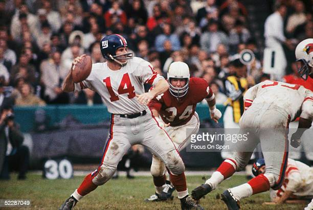 New York Giants' quarterback YA Tittle steps back to pass during a NFL game against the St Louis Cardinals circa 19611964