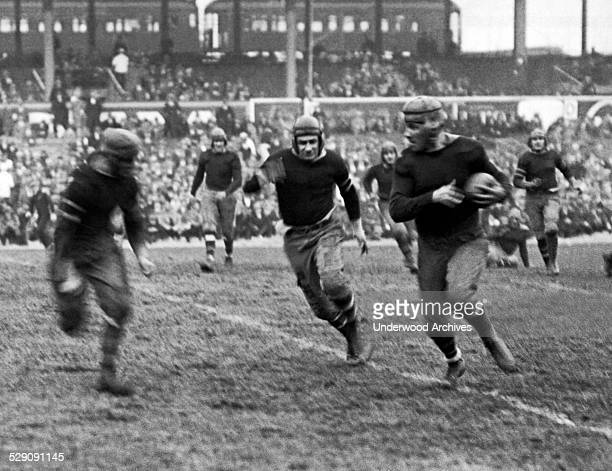 New York Giants rookie running back Heinie Benkert from Rutgers about to be tackled after a 30 yard run in a game against the Rochester Jeffersons...