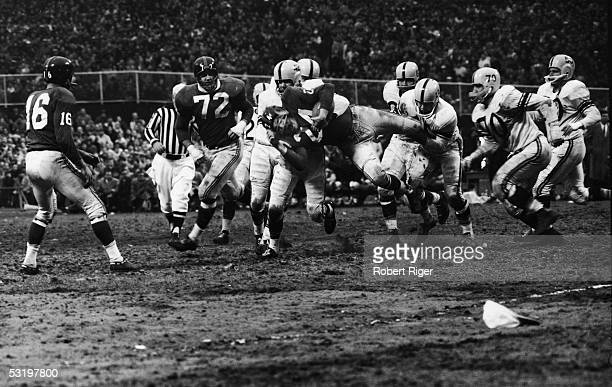 New York Giants runner Phil King is tackled by Pittsburgh Steelers players Dick Alban George Tarasovic Jack Call Ernie Stoutner and John Reger during...