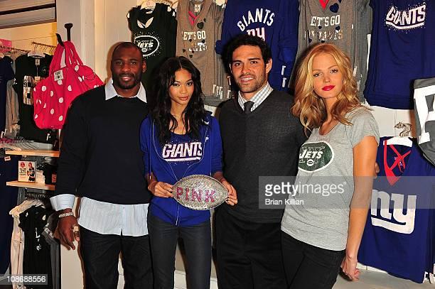 New York Giants running back Brandon Jacobs model Chanel Iman New York Jets quarterback Mark Sanchez and model Erin Heatherton attend VS PINK...