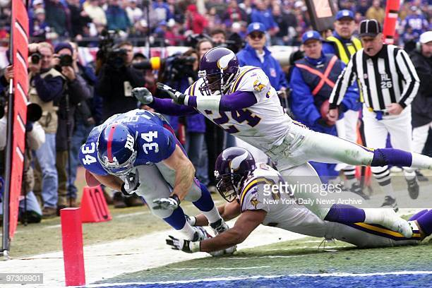 New York Giants' running back Greg Comella crosses the goal line for a score against the Minnesota Vikings in the NFC Championship Game at Giants...