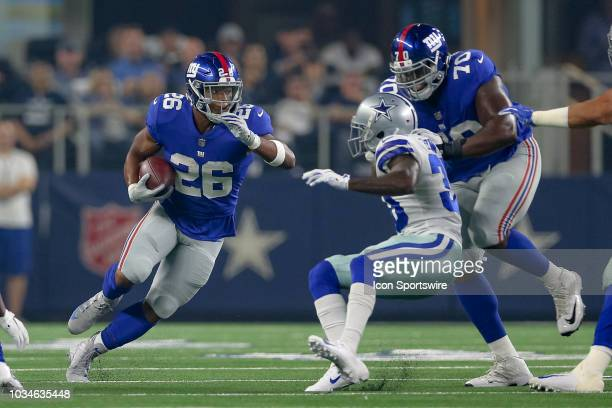 New York Giants running back Saquon Barkley cuts back inside behind the block of New York Giants offensive guard Patrick Omameh during the game...