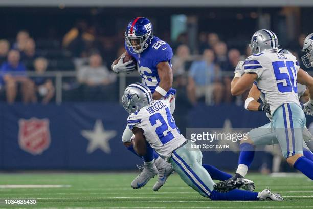 New York Giants running back Saquon Barkley is tackled by Dallas Cowboys cornerback Chidobe Awuzie during the game between the New York Giants and...