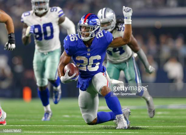New York Giants running back Saquon Barkley makes a cut during the game between the New York Giants and Dallas Cowboys on September 16 2018 at ATT...