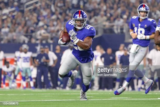 New York Giants running back Saquon Barkley tries to break around the edge during the game between the New York Giants and Dallas Cowboys on...