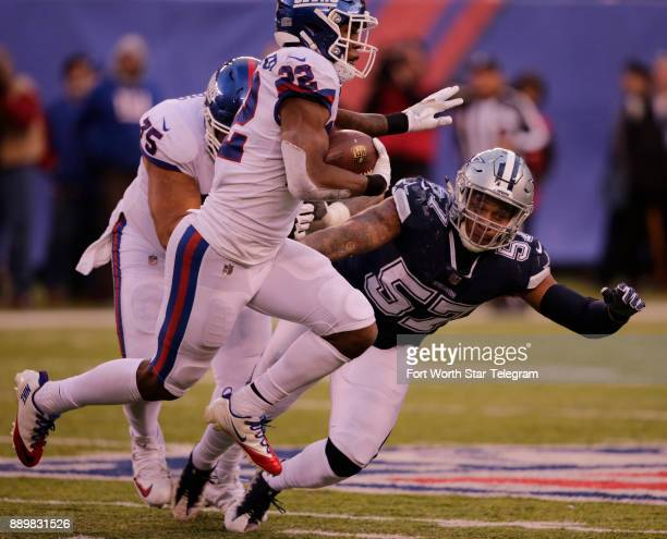 New York Giants running back Wayne Gallman carries the ball in the fourth quarter pursued by Dallas Cowboys linebacker Damien Wilson on Sunday Dec 10...