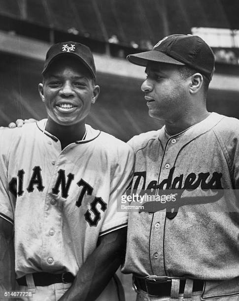 New York Giants star outfielder Willie Mays smiles as he stands with Brooklyn Dodgers catcher Roy Campanella at the Polo Grounds in New York ca...
