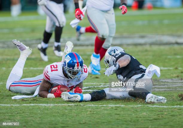 New York Giants strong safety Landon Collins puts his body over the ball during the game between the Oakland Raiders and the New York Giants on...