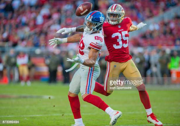 New York Giants tight end Evan Engram bobbles the ball while being guarded by San Francisco 49ers strong safety Eric Reid during the regular season...