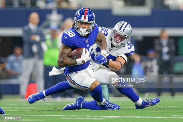 New York Giants Tight End Evan Engram is tackled by Dallas Cowboys Safety Jeff Heath during the game between the New York Giants and the Dallas...