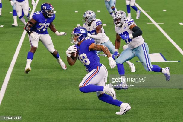 New York Giants Tight End Evan Engram scores a touchdown during the NFL game between the New York Giants and Dallas Cowboys on October 11, 2020 at...