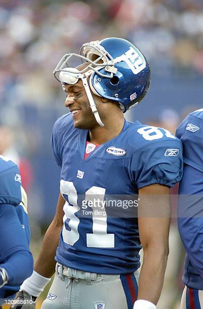 New York Giants Wide Receiver Amani Toomer smiling on the sidelines after a touchdown catch in the second quarter during Philadelphia Eagles vs New...