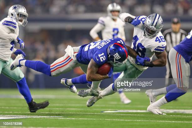 New York Giants wide receiver Cody Latimer is hit by Dallas Cowboys linebacker Joe Thomas during the game between the New York Giants and Dallas...