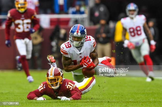 New York Giants wide receiver Corey Coleman drops a pass on a play where Washington Redskins cornerback Fabian Moreau was called for pass...