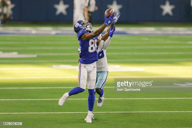 New York Giants Wide Receiver Darius Slayton makes a catch over a defending Dallas Cowboys Cornerback Jourdan Lewis during the NFL game between the...