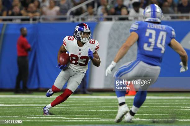 New York Giants wide receiver Kalif Raymond runs the ball under the pressure of Zach Zenner during the second half of an NFL football game against...
