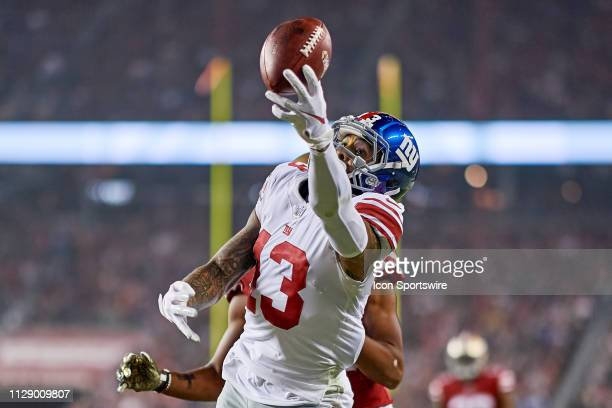 New York Giants wide receiver Odell Beckham battles with San Francisco 49ers cornerback Ahkello Witherspoon in an attempt to catch the football...