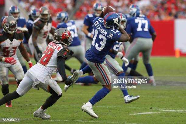New York Giants wide receiver Odell Beckham catches a pass infant of Tampa Bay Buccaneers cornerback Vernon Hargreaves during the NFL game between...