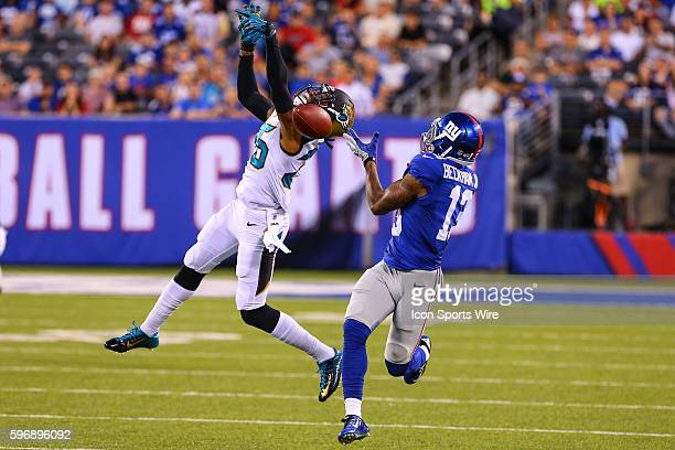New York Giants wide receiver Odell Beckham tries to make the catch against Jacksonville Jaguars cornerback Demetrius McCray during the first quarter...