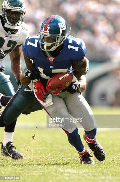 New York Giants wide receiver Plaxico Burress loses the handle on the ball and fumbles against the Philadelphia Eagles on Sunday September 17 2006 at...