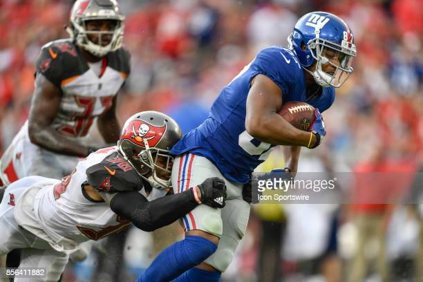 New York Giants wide receiver Sterling Shepard is brought down by Tampa Bay Buccaneers cornerback Robert McClain after a catch during an NFL football...