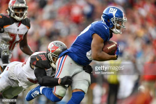New York Giants wide receiver Sterling Shepard is tackled by Tampa Bay Buccaneers cornerback Robert McClain after a reception during an NFL football...