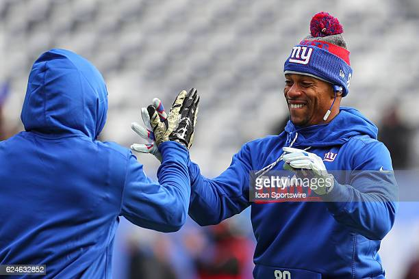 New York Giants wide receiver Victor Cruz and New York Giants wide receiver Odell Beckham shake hands prior to the NFL game between the New York...