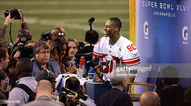 New York Giants wide receiver Victor Cruz, who attended UMass, is pictured as he gets up to leave after finishing answering questions during the...