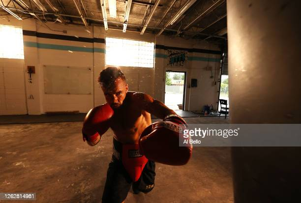 New York Golden Gloves boxer Dennis Guerrero hits the heavy bag during a final boxing workout at Jetty gym on July 30 2020 in Oceanside New York...