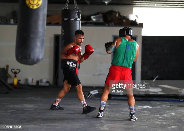 New York Golden Gloves boxer Dennis Guerrero spars with Amateur kickboxer Sal Carillo during a final boxing workout at Jetty gym on July 30 2020 in...