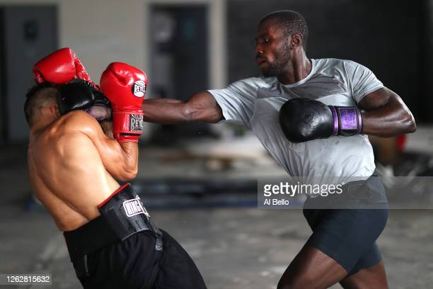 New York Golden Gloves boxer Dennis Guerrero spars with recreational boxer Raheem Yusuff during a final boxing workout at Jetty gym on July 30 2020...