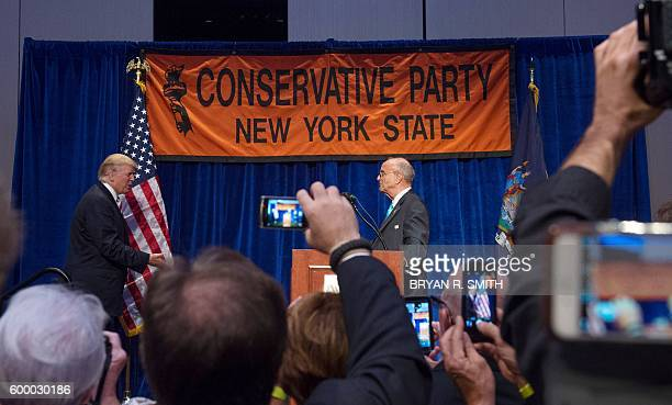 New York GOP Chairman Mike Long introduces Republican presidential nominee Donald Trump at the New York State Conservative Party Presidential...