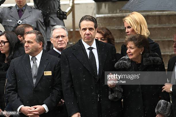 New York Gov Andrew Cuomo and his mother Matilda Cuomo watch as the casket of former threeterm governor Mario Cuomo departs St Ignatius Loyola Church...
