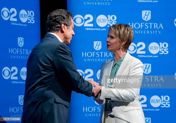 New York Gov Andrew Cuomo and primary opponent Cynthia Nixon shake hands before a debate at Hofstra University August 29 2018 in Hempstead New York...