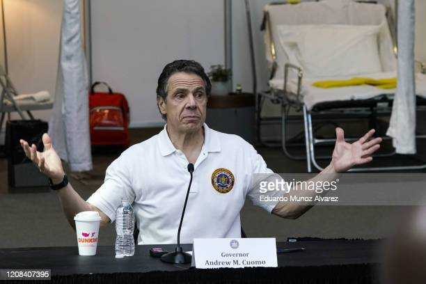 New York Gov Andrew Cuomo gives a daily coronavirus press conference in front of media and National Guard members at the Jacob K. Javits Convention...