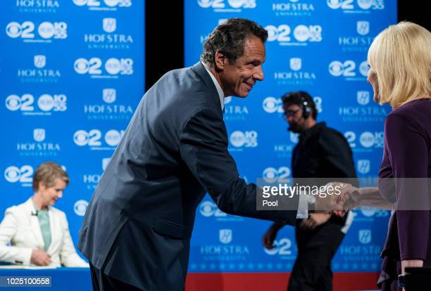 New York Gov Andrew Cuomo shakes hands with a moderator as opponent primary opponent Cynthia Nixon prepares before a debate at Hofstra University...