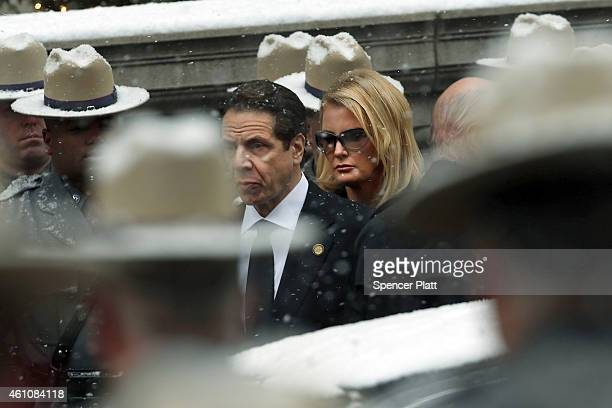 New York Gov Andrew Cuomo walks with his girlfriend Sandra Lee as a hearse carrying the casket of his father former threeterm governor Mario Cuomo...