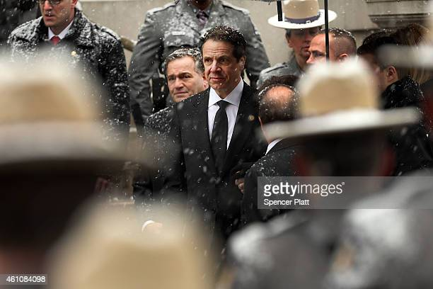 New York Gov Andrew Cuomo watches as the hearse carrying the casket of his father former threeterm governor Mario Cuomo arrives at St Ignatius Loyola...