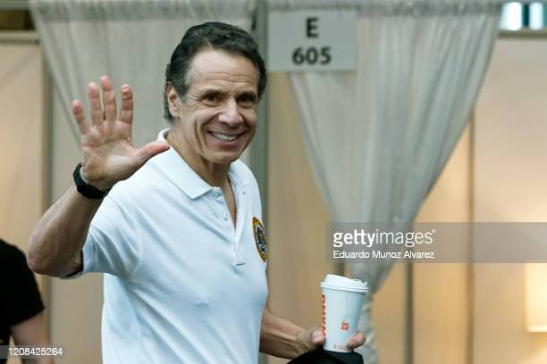 New York Gov Andrew Cuomo waves after giving a daily coronavirus press conference at the Jacob K Javits Convention Center which is being turned into...