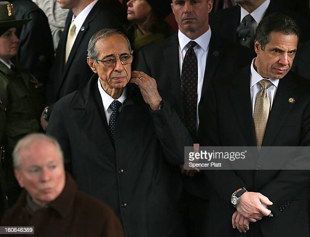 New York Governor Andrew Cuomo and his father former Governor Mario Cuomo exit funeral services for former New York Mayor Ed Koch at Manhattan's...