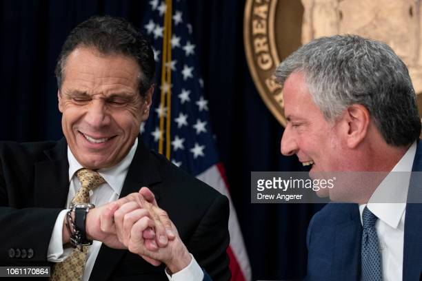 New York Governor Andrew Cuomo and New York City Mayor Bill de Blasio shake hands during a press conference to discuss Amazon's decision to bring a...