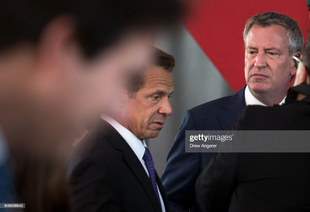 New York Governor Andrew Cuomo and New York City Mayor Bill de Blasio speak to each other briefly as they arrive for the dedication ceremony to mark the opening of the new campus of Cornell Tech on Roosevelt Island, September 13, 2017 in New York City. Seven years ago, former New York City Mayor Michael Bloomberg created a competition that invited top universities to open an applied-science campus in New York City. Cornell Tech, an engineering and science campus of Cornell University, officially opened its doors on Wednesday.