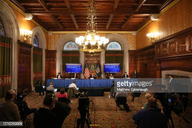 New York Governor Andrew Cuomo, center, seated at table, gives his a press briefing about the coronavirus crisis on April 17, 2020 in Albany, New...