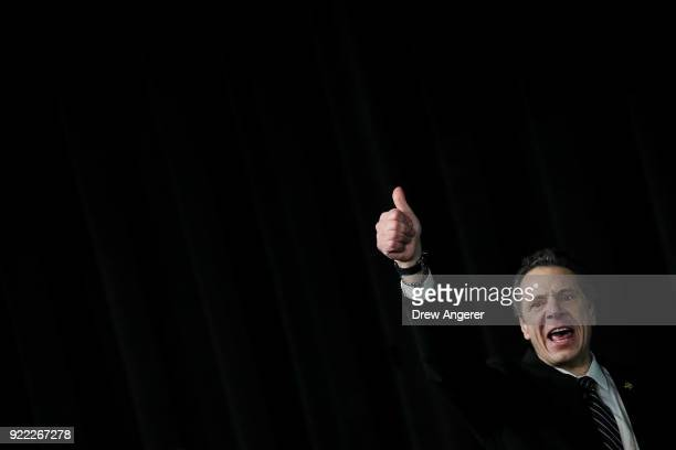 New York Governor Andrew Cuomo gives a thumbs up after speaking at a healthcare union rally at the Theater at Madison Square Garden February 21 2018...