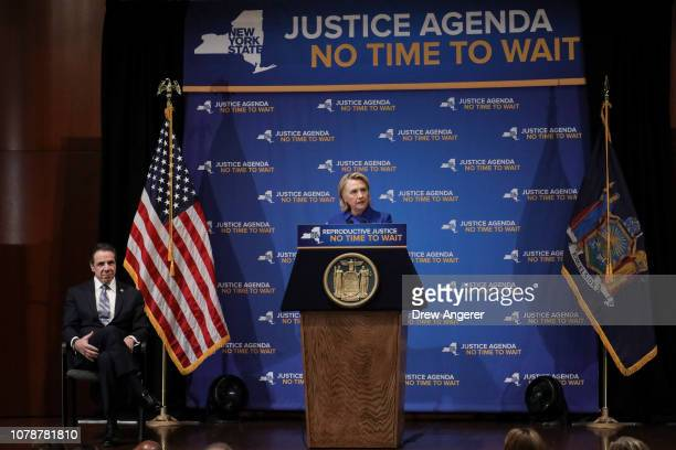 New York Governor Andrew Cuomo looks on as former Secretary of State Hillary Clinton speaks about reproductive rights at Barnard College January 7...