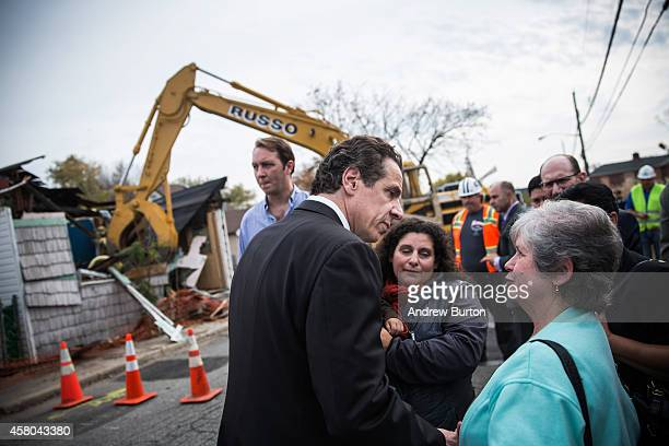 New York Governor Andrew Cuomo meets with citizens after a press conference about New York state's program to buy back homes destroyed by Hurricane...