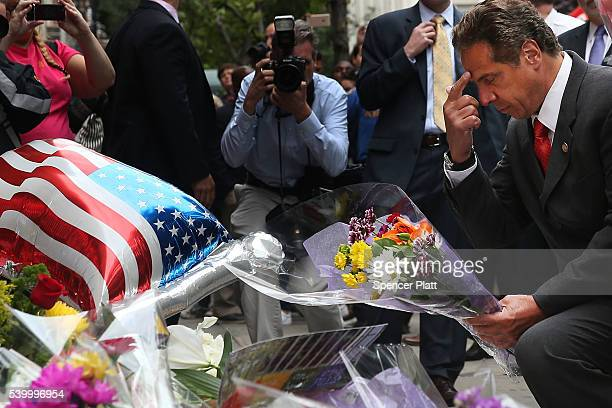 New York Governor Andrew Cuomo pauses in front of the iconic New York City gay and lesbian bar The Stonewall Inn to lay flowers and grieve for those...